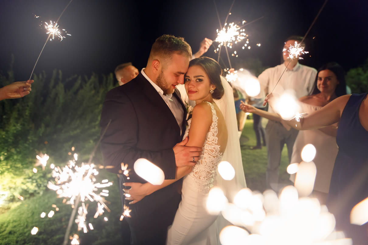 wedding couple dancing outdoors at night